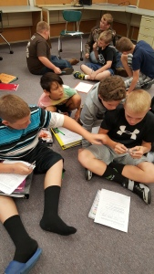 Students comparing tuning forks